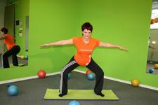 Pilates široki počep - končni položaj